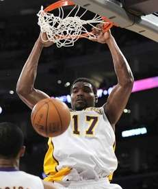 Los Angeles Lakers center Andrew Bynum dunks against