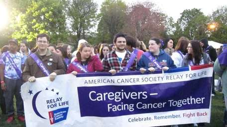Cancer survivors and caregivers led the first lap