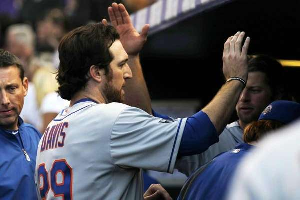 New York Mets' Ike Davis celebrates with teammates
