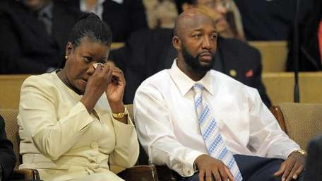 Sybrina Fulton, left, wipes her eyes as Tracy
