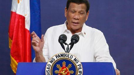 Philippine President Rodrigo Duterte gestures as he addresses