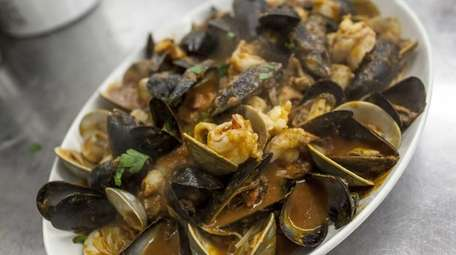 A family-style portion of seafood fra diavolo at