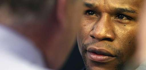 Floyd Mayweather Jr. speaks to the media prior