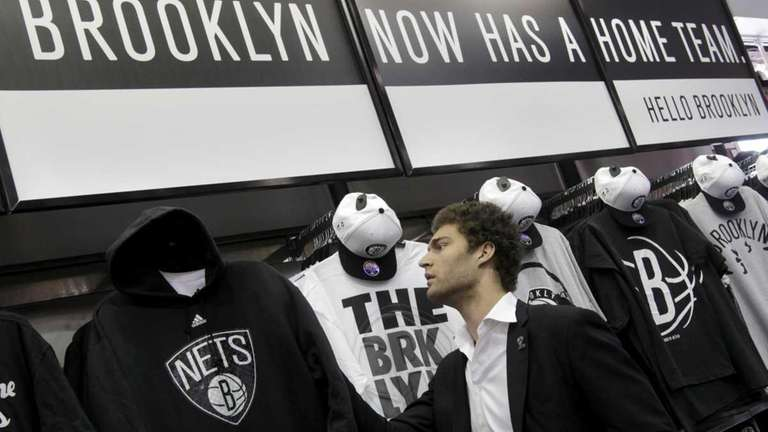 Brooklyn Nets basketball player Brook Lopez looks at