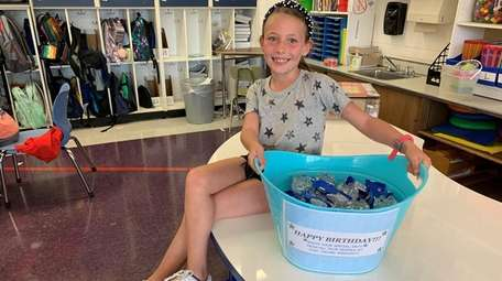 Emma Kaplan, 8, a Plainview third-grader, shows the