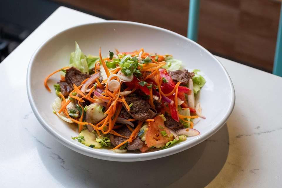 The BBQ beef salad, which features sliced steak,