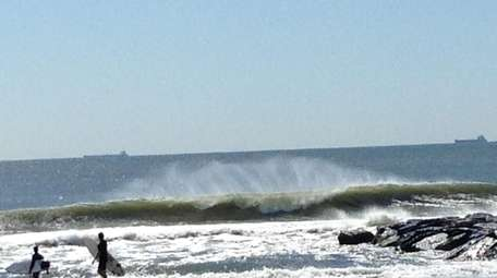 Waves break off of Long Beach, N.Y., in