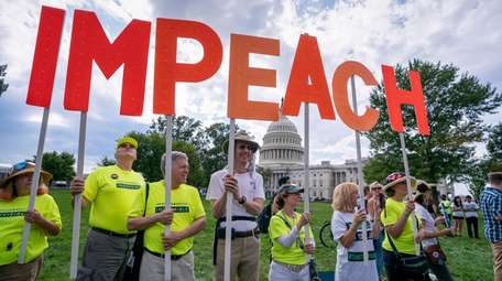 Activists rally for the impeachment of President Donald