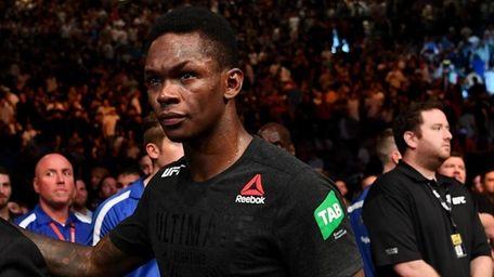 Israel Adesanya walks from the Octagon after winning