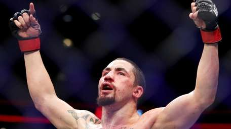 Robert Whittaker of New Zealand celebrates after his