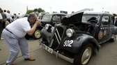 A photographer focuses on one of the Citroen