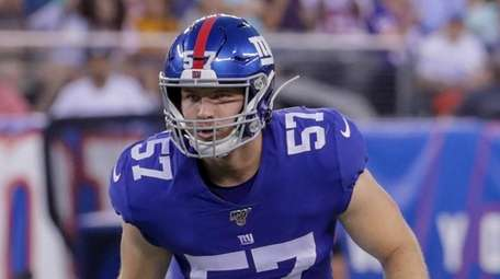 Giants inside linebacker Ryan Connelly signals a formation