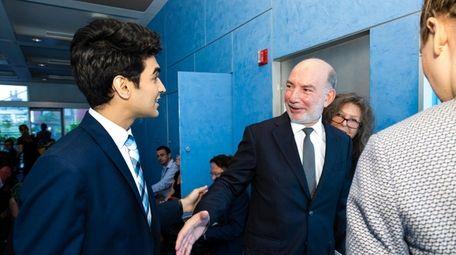 Saad Amer, left, meets Luis Alfonso de Alba,
