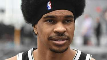 Nets center Jarrett Allen speaks with reporters during