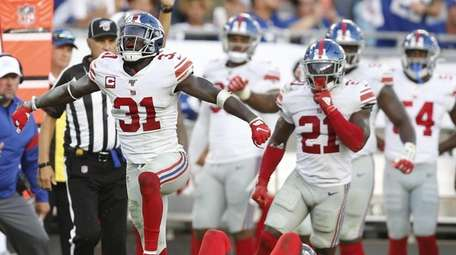 Safety Michael Thomas of the Giants celebrates after