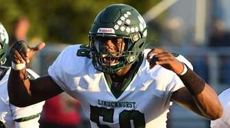 Lindenhurst's Sunkonmi Agunloye runs to his team after