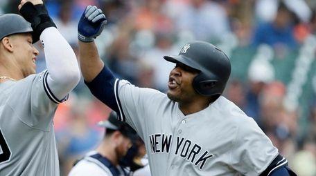 Yankees' Edwin Encarnacion, right, celebrates his two-run home