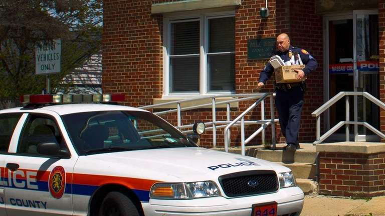 A Police officer leaves the 8th precinct, on