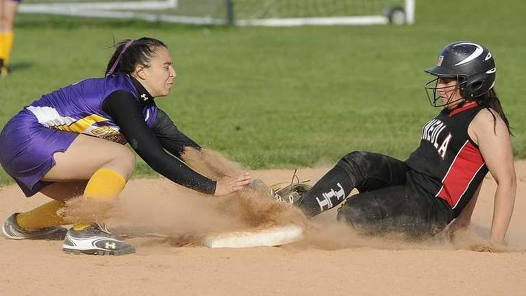 Mineola's Emily Skupp steals second base before Oyster