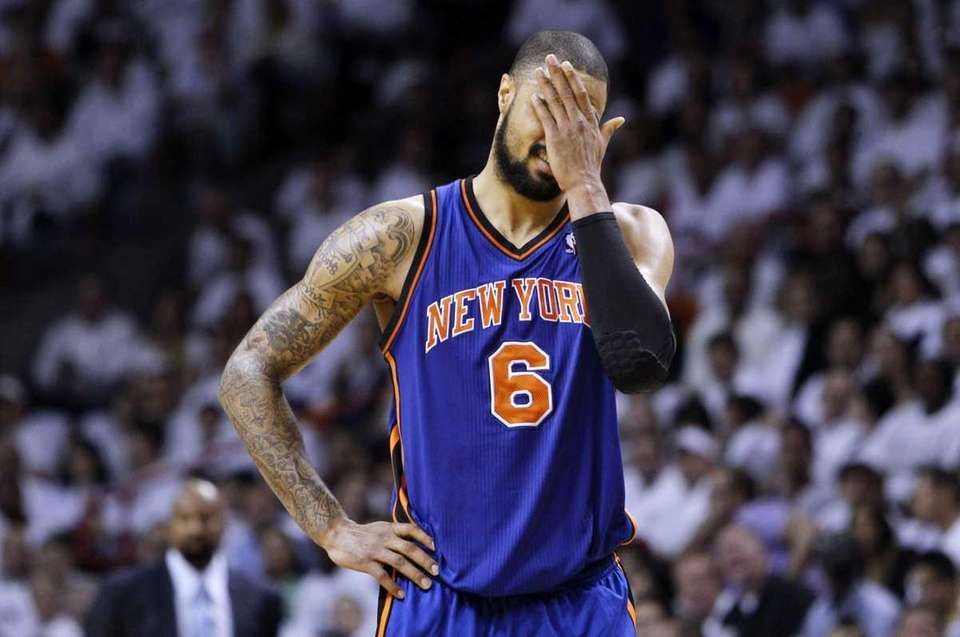 New York Knicks' Tyson Chandler (6) reacts after