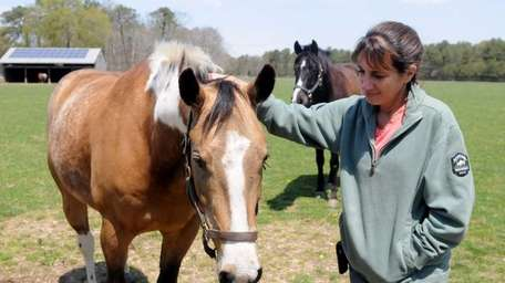 Mona Kanciper on her farm in Manorville on