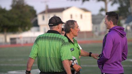 Head Coach Zachary Gosse of Mepham talks with
