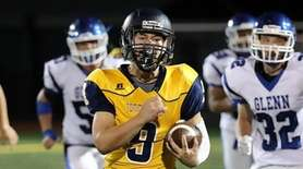 Shoreham-Wading River running back Max Barone outruns the