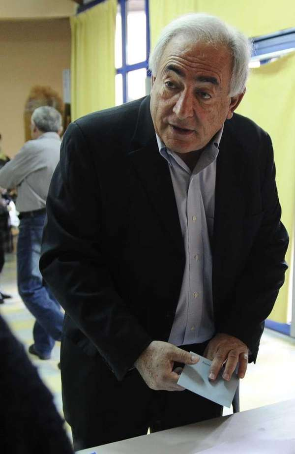 Dominique Strauss-Kahn registers to vote during the first