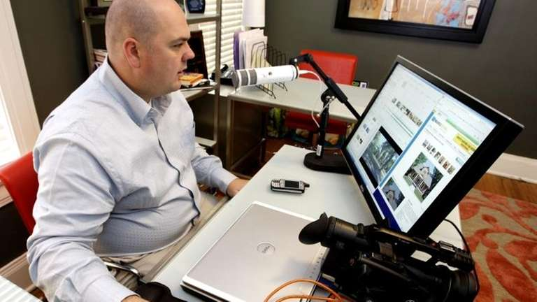 Realty agent Brian Copeland works on a website