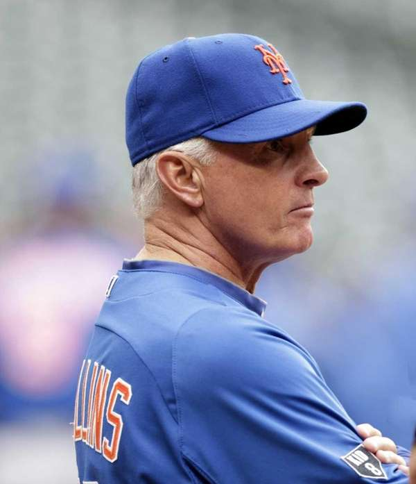 Terry Collins watches batting practice before playing the