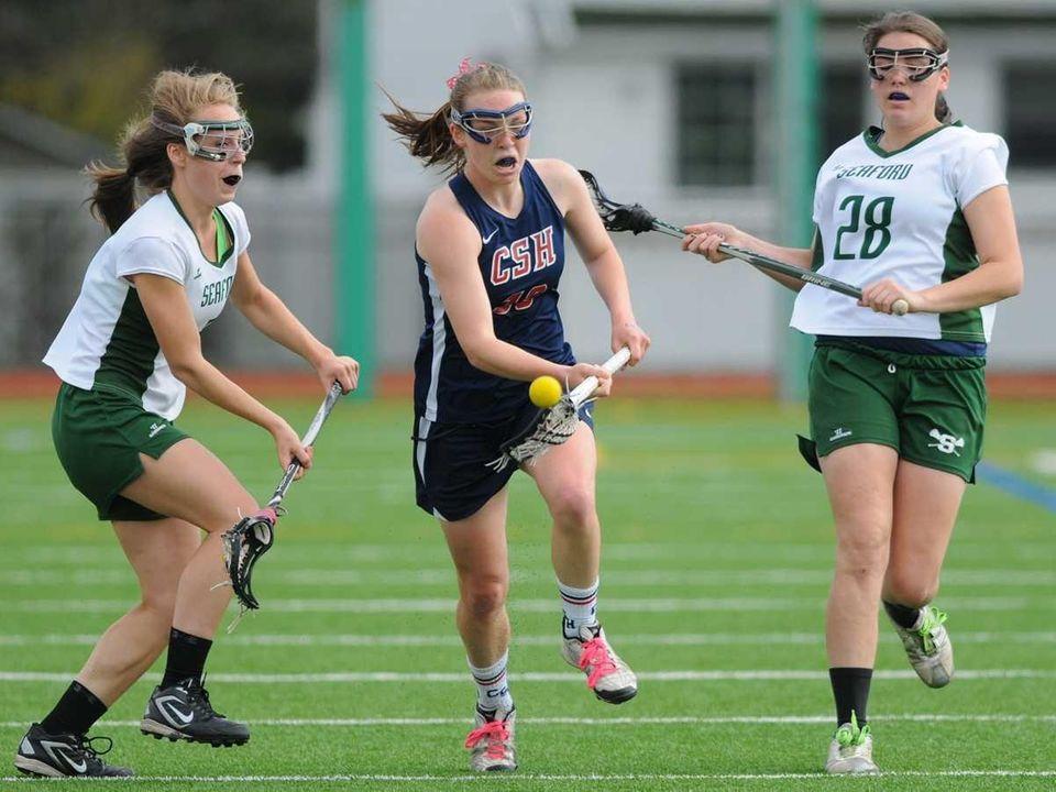 Seaford teammates #5 Carolyn Lo Strappo, left, and