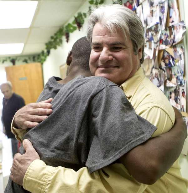Volunteer Brian Abramowitz receives a hug from one