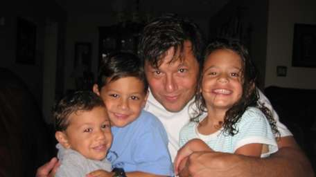 Mike Mangianello, pictured with his three children, Johnny,