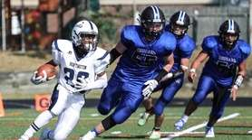 Huntington's Josiah Melendez has the Centereach defense trailing