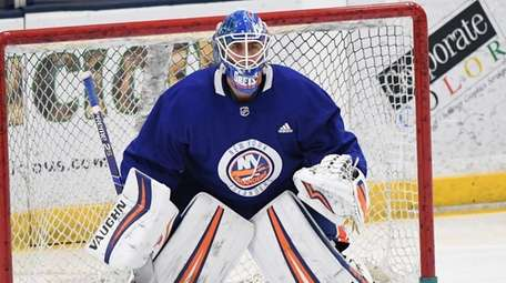 Islanders goaltender Thomas Greiss protects the net during