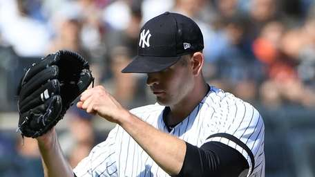 Yankees starting pitcher James Paxton pumps his fist
