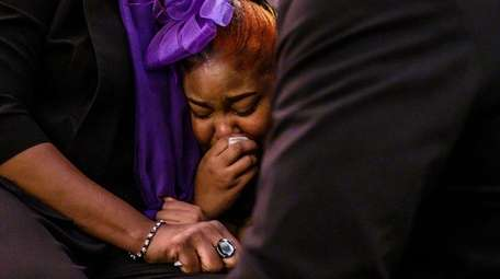 Keyanna Morris is comforted during funeral services for