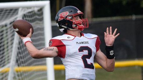 Quarterback Daniel Villari of Plainedge prepares to pass