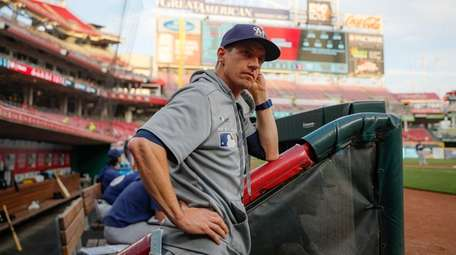 Milwaukee Brewers manager Craig Counsell stands in the