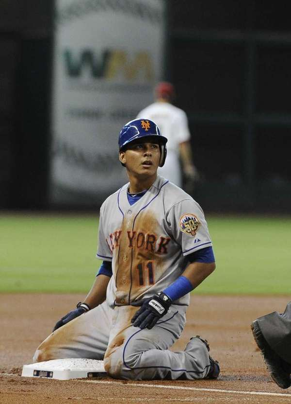 New York Mets' Ruben Tejada looks toward the