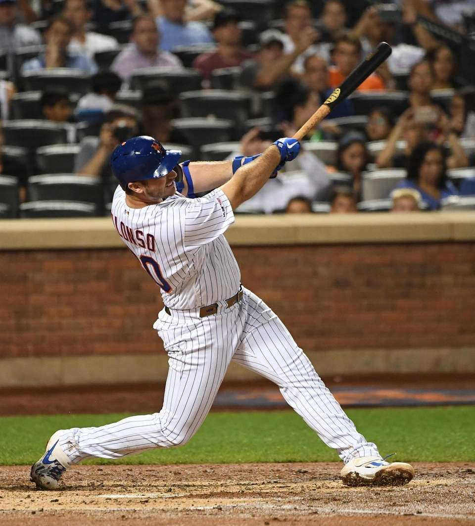New York Mets' Pete Alonso follows through on