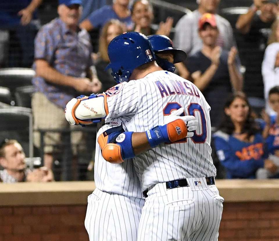 New York Mets' Pete Alonso is embraced by