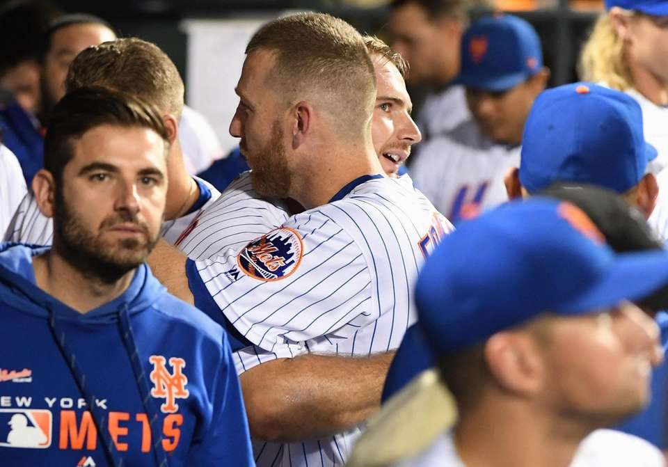 New York Mets' Pete Alonso is greeted in
