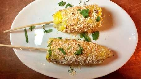 Mexican street corn is one of the sides