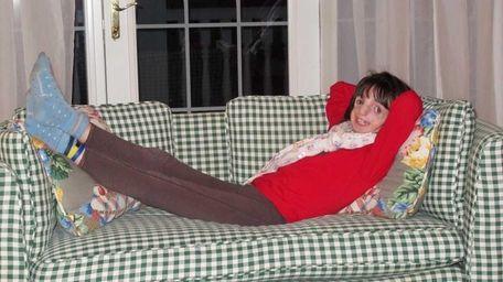 Clara Beatty, 9, smiles as she reclines on