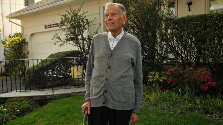 Harold Herman stands in front of his Fordham