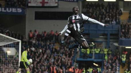 Newcastle's Papiss Cisse jumps high as he celebrates