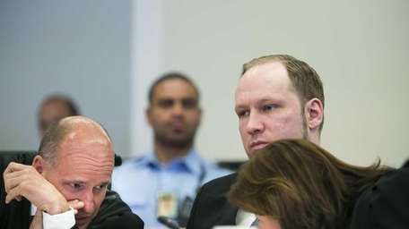Anders Behring Breivik, center, looks on as his