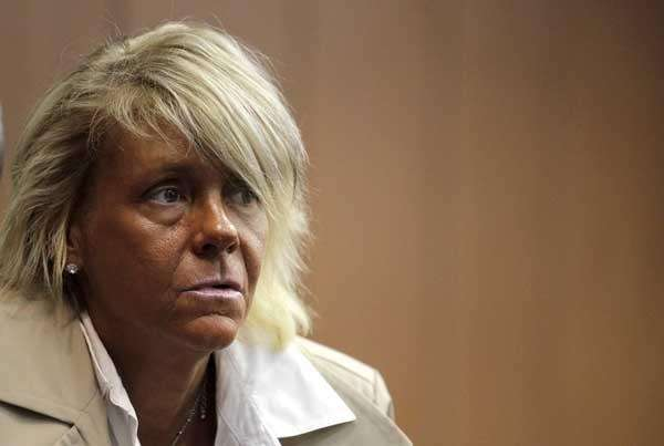 Patricia Krentcil waits to be arraigned Wednesday, May