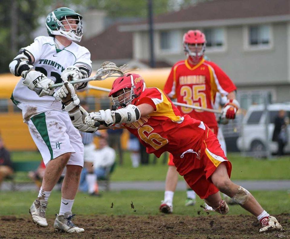 Holy Trinity's Jake Mazzola #32 puts the shot